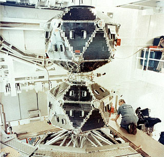 A pair of Vela satellites in the clean room prior to launch: The Vela satellites are stacked one on top of the other in a clean room prior to the launch.  The two polyhedron-shaped satellites (with 20 sides) would detach from each other after launch.