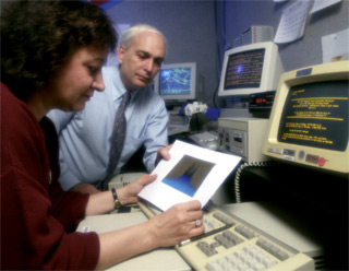 Reviewing Data From the Burst and Transient Source Experiment (BATSE): Dr. Gerald Fishman (Marshall Space Flight Center), and his colleague Dr. Chryssa Kouveliotou (Universities Space Research Associates) review data from the the Burst and Transient Source Experiment (BATSE).  Dr. Fishman was the Principal Investigator of the BATSE instrument, aboard the Compton Gamma-Ray Observatory's (CGRO).