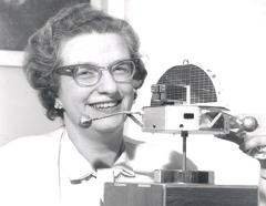 Nancy Roman: Dr. Nancy Roman, one of the nation's top scientists in the space program, is shown with a model of the Orbiting Solar Observatory (OSO) in 1963.