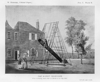 Herschel's Twenty-foot Telescope:  Drawing of the 20-foot telescope from The Scientific Papers of Sir William Herschel published in London in 1912 by the Royal Society and the Royal Astronomy Society.  The drawing depicts an astronomer on a ladder looking through the eyepiece located at the top of the telescope, far from the primary mirror at the foot of the telescope, and an assistant at the foot of the telescope taking notes.