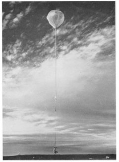 Stratoscope II After Launch: At launch, the heavy-lift launch balloon is inflated above the uninflated main balloon.  The observatory is 660 feet tall at launch. For more information about Stratoscope II, see Danielson, R. E., AmSci, 51, 375.