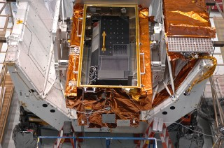 Cosmic Origins Spectrograph: COS (black box) sits in its protective carrier waiting for delivery to the Hubble Telescope.