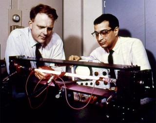 Early Gas Laser: William Ralph Bennett, Jr. and Ali Javan work with a helium-neon optical gas maser at Bell Laboratories. Their laser was first tested on December 12, 1960. The next day, they used it to transmit the first telephone conversation across a laser beam.
