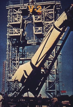 V-2 Rocket:  A V-2 rocket is hoisted into a static test facility at White Sands, New Mexico. The German engineers and scientists who developed the V-2 came to the United States at the end of World War II and continued rocket testing under the direction of the U. S. Army, launching more than sixty V-2s.