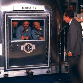 President Nixon Visits Apollo 11 Crew in quarantine: President Richard M. Nixon welcomes the Apollo 11 astronauts aboard the U.S.S. Hornet, the prime recovery ship for the historic Apollo 11 lunar landing mission. Pictured are (left to right) Neil A. Armstrong, commander; Michael Collins, command module pilot; and Edwin E. Aldrin Jr., lunar module pilot. Apollo 11 splashed down on July 24, 1969, about 812 nautical miles southwest of Hawaii.