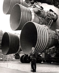 Wernher von Braun: A pioneer of America's space program, Dr. von Braun stands by the five F-1 engines of the Saturn V Dynamic Test Vehicle on display at the U.S. Space & Rocket Center in Huntsville, Alabama, circa 1969. Dr. von Braun served as the first director of the NASA Marshall Space Flight Center and was the chief architect of the Saturn V launch vehicle, the superbooster that propelled the Apollo spacecraft to the Moon.
