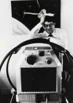 Image Title: Riccardo Giacconi stands with the Uhuru satellite, circa 1970.